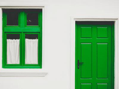 Building with green doors by Buzac Marius via Unsplash