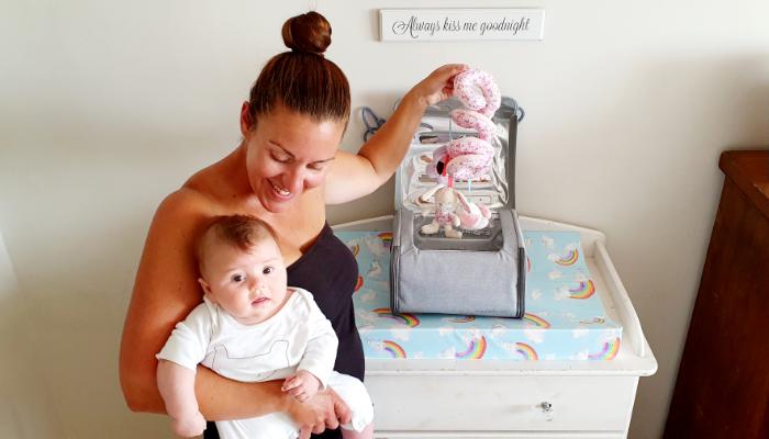 Natalie of Crummy Mummy with baby and Munchkin nursery steriliser